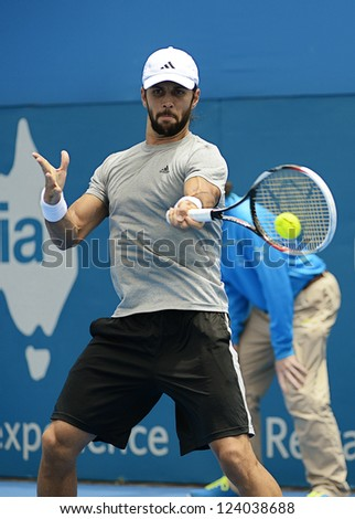 SYDNEY - JAN 9: Fernando Verdasco from Spain hits a forehand in his second round match in the APIA Sydney Tennis International. Sydney January 9, 2013. - stock photo