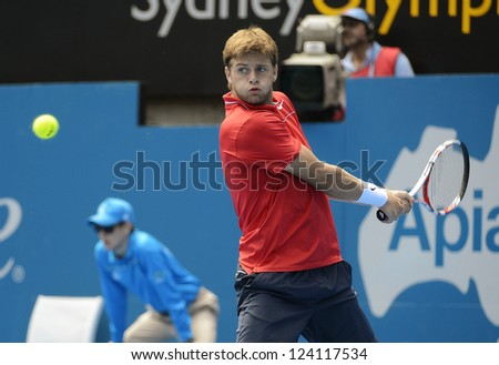 SYDNEY - JAN 9: Ryan Harrison from the USA hits a backhand in his second round match in the APIA Sydney Tennis International. Sydney January 9, 2013. - stock photo