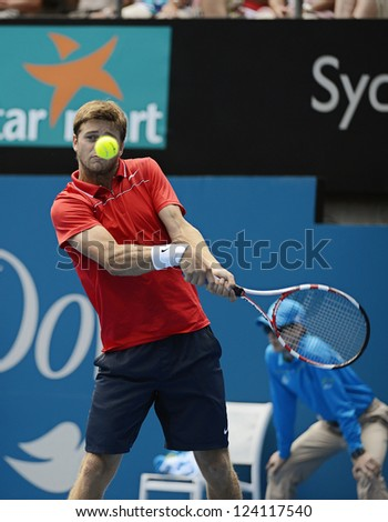 SYDNEY - JAN 9: Ryan Harrison from the USA keeps his eyes on the ball, during his second round match in the APIA Sydney Tennis International. Sydney January 9, 2013. - stock photo