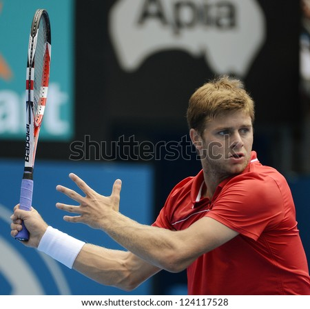 SYDNEY - JAN 9: Ryan Harrison from the USA lines up a forehand during his second round match in the APIA Sydney Tennis International. Sydney January 9, 2013. - stock photo