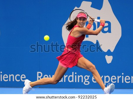 SYDNEY - JAN 8: Serbian Ana Ivanovic prepares for a backhand during her first round match in the APIA Tennis International. Sydney - January 8, 2012 - stock photo