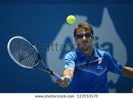 SYDNEY - JAN 8: Tommy Robredo from Spain hits a volley in his first round match in the APIA Sydney Tennis International. Sydney January 8, 2013.