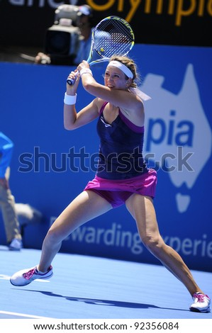 SYDNEY - JAN 9: Victoria Azarenka from Belarus hits a backhand in her first round match in the APIA Tennis International. Sydney - January 9, 2012