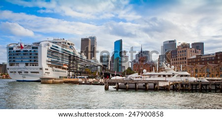 SYDNEY - JANUARY 5: Circular Quay in Sydney, Australia on September 5, 2014. Sydney is the capital of New South Wales and the most populated city in Australia.  January 5, 2014 in Sydney, Australia. - stock photo