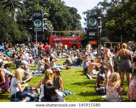 Sydney-January 7 : People enjoy music by DJ at Hyde park  for Sydney festival  in  Sydney,Australia on January 7,2012. Sydney festival start about January every year . - stock photo