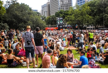 Sydney-January 7 : People enjoy music by DJ at Hyde park  for Sydney festival  in  Sydney,Australia on January 7,2012. Sydney festival start about January every year . - stock photo