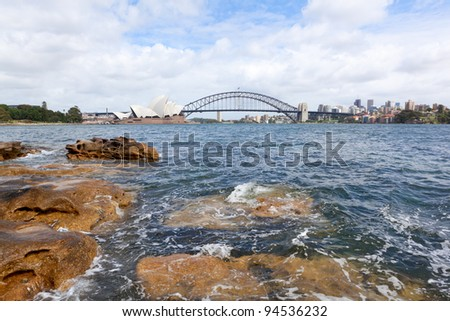 SYDNEY - JANUARY 23: Side view of Sydney Opera House during the Chinese New Year January 23, 2012 in Sydney, Australia. - stock photo