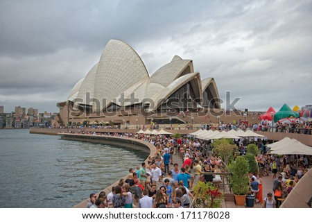 SYDNEY - JANUARY 12: Sydney Opera House view on January 12, 2014 in Sydney, Australia. The Sydney Opera House is a famous arts center. It was designed by Danish architect Jorn Utzon.  - stock photo
