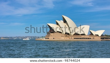 SYDNEY - JANUARY 26: Sydney Opera House view on January 26, 2012 in Sydney, Australia. The Sydney Opera House is a famous arts center. It was designed by Danish architect Jorn Utzon, opening in 1973. - stock photo