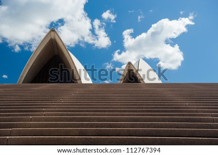 SYDNEY - JANUARY 11: The Iconic Sydney Opera House, became a UNESCO World Heritage Site on 28 June 2007 sits on the edge of Circular Quay.  January 11, 2012 in Sydney, Australia. - stock photo
