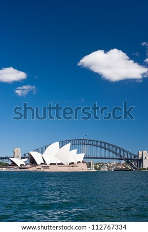 SYDNEY - JANUARY 11: The Iconic Sydney Opera House is a multi-venue performing arts centre also containing bars and outdoor restaurants.  January 11, 2012 in Sydney, Australia. - stock photo