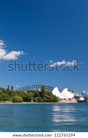 SYDNEY - JANUARY 11: The Iconic Sydney Opera House is a multi-venue performing arts centre sits at the edge of the Royal Botanical Gardens.  January 11, 2012 in Sydney, Australia. - stock photo