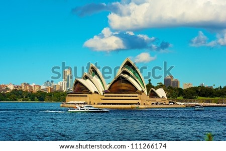 SYDNEY - JULY 8: Sydney Opera House view on July 8, 2012 in Sydney, Australia. The Sydney Opera House is a famous arts center. It was designed by Danish architect Jorn Utzon, finally opening in 1973. - stock photo