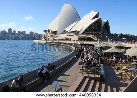 SYDNEY - JUNE 13: Opera House on Queen's Birthday public holiday with people eating and walking around on June 13 2016
