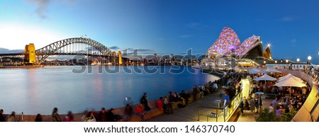 SYDNEY - JUNE 6: The Sydney Opera House, Australia on June 6, 2009. It was designed by Danish architect Jorn Utzon and hosts over 1,500 performances each year. - stock photo