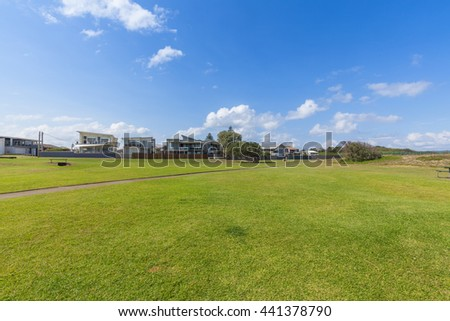 Sydney, lawn in front of city buildings - stock photo
