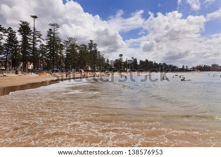 sydney manly beach zone day time ocean wave in bay people relaxing and surfing in the residential town