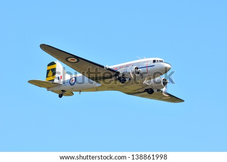 SYDNEY - MAY 5: A DC-3 Dakota military transport performs a flyby during the Wings Over Illawarra Airshow on May, 2013 near Sydney. - stock photo
