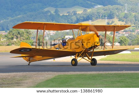 SYDNEY - MAY 5: A Tiger Moth vintage aeroplane taxies to the runway during the Wings Over Illawarra Airshow on May, 2013 near Sydney. - stock photo