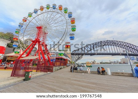 SYDNEY - MAY 10: Tourists visit Lunar Park on May 10, 14 in Sydney. It is an amusement park located at Milsons Point in Sydney, NSW, Australia.