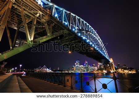 Sydney night cityscape under the bridge