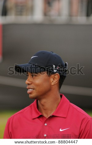 SYDNEY - NOV 13: American golfer Tiger Woods waiting at the presentation at the Emirates Australian Open at The Lakes golf course. Sydney - November 13, 2011 - stock photo