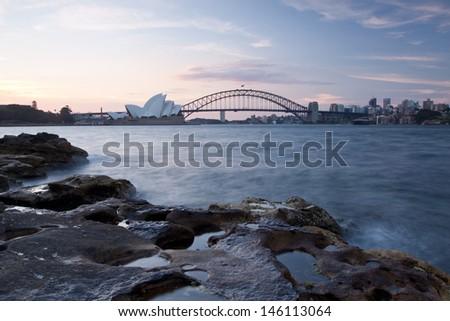 SYDNEY - NOV 26:Night view of Sydney Harbour Bridge and Opera House in Sydney, Australia on November 26,2011. The Harbour Bridge is the world's widest long-span bridge. Opera House is the landmark. - stock photo