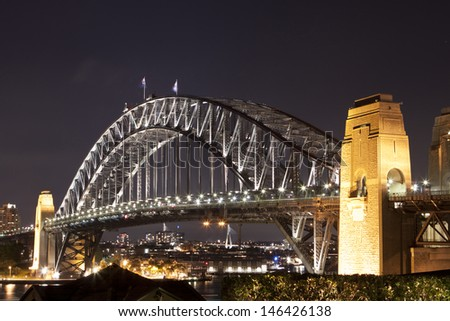 SYDNEY - NOV 26:Night view of Sydney Harbour Bridge in Sydney, Australia on November 26,2011. The Harbour Bridge is the world's widest long-span bridge.  - stock photo