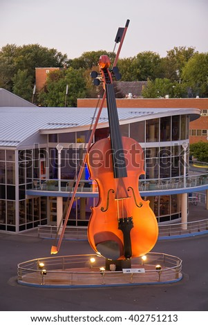 SYDNEY, NOVA SCOTIA, CANADA - SEPTEMBER 21, 2011: The Big Fiddle greets cruise ships passengers to this city. It is the largest fiddle in the world with a height of 60 feet/18.3 meters.