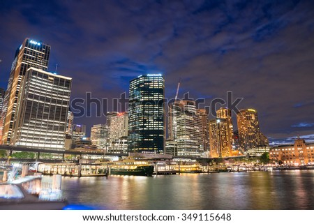 SYDNEY - NOVEMBER 8, 2015: Beautiful city skyline at dusk. Sydney attracts 15 million tourists annually.