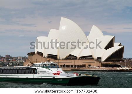 SYDNEY - NOVEMBER 23: Sydney Opera House view on November 23, 2013 in Sydney, Australia. The Landmark is a famous arts center. It was designed by Danish architect Jorn Utzon, finally opening in 1973. - stock photo