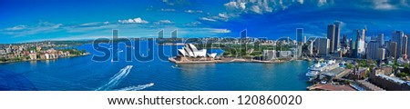 SYDNEY - NOVEMBER 7: The Sydney Opera House and the Sydney Harbor in Sydney, Australia on November 7, 2012. The Opera House was designed by Danish architect Jorn Utzon. - stock photo