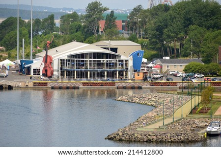 SYDNEY, NS, CANADA - AUG 2, 2014:  The Joan Harriss Cruise Pavilion is a multi-use building on the Marine Terminal and since May 2014 features a restaurant called Flavor on the Water on the 2nd floor. - stock photo