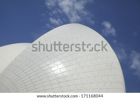 """SYDNEY, NSW, AUSTRALIA - DECEMBER 27: A view of the famous Sydney Opera House on December 27, 2013. The building's design features a series of large precast concrete """"shells"""" said to look like sails. - stock photo"""