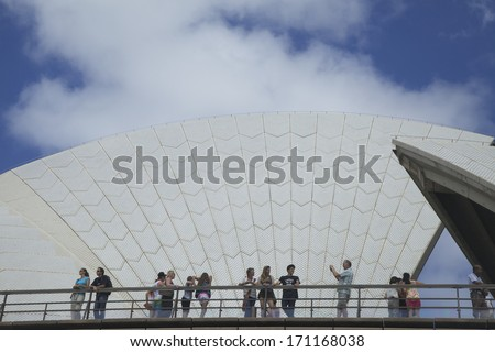 SYDNEY, NSW, AUSTRALIA - DECEMBER 27: Tourists gather outside the famous Sydney Opera House in Sydney on December 27, 2013. The Opera House became a UNESCO World Heritage Site on 28 June 2007. - stock photo