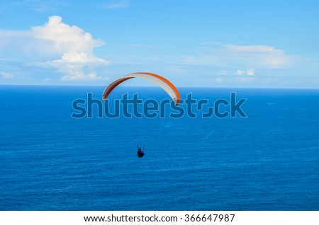 SYDNEY, NSW / AUSTRALIA - JULY 22: Paraglider above the sea, from Stanwell Tops (Bald Hill Lookout) on 22 July 2014.