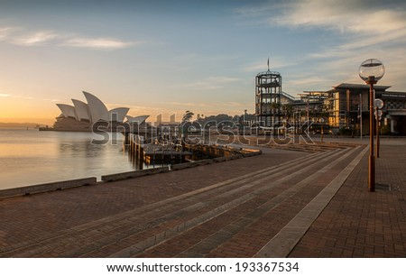 SYDNEY, NSW/AUSTRALIA-July 28 : Sunrise at Opera house landmark of Sydney city and Australia locate in Sydney harbor on July 28, 2013. - stock photo