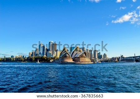 SYDNEY, NSW / AUSTRALIA - JULY 5, 2014: View from ferry, City CBD and Opera House  on July 5, 2014. in Sydney, Australia.