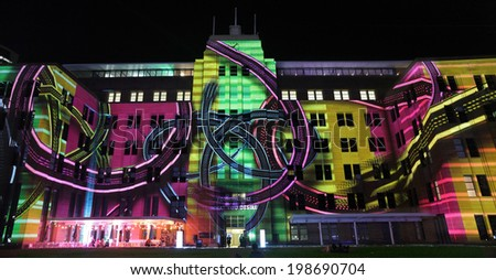 SYDNEY, NSW, AUSTRALIA - JUNE 2, 2014; Museum of Contemporary Art comes alive with projections of moving imagery and music  during Vivid Sydney festival event for locals and tourists to enjoy.