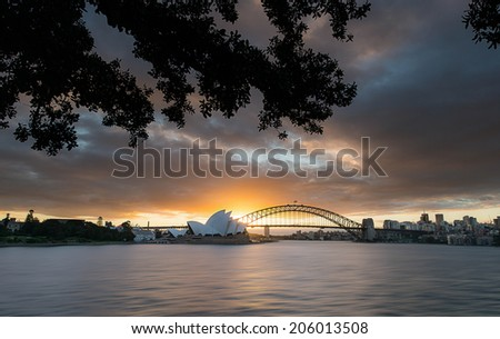 SYDNEY, NSW/Australia-June 17 : Sunset at Opera house from Mrs Macquarie's  Chair lookout  on June 17, 2013. - stock photo