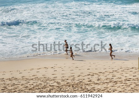 Sydney NSW, Australia, March 26 2017. Family running around the sea spending their day off with family at Bronte beach, Sydney.