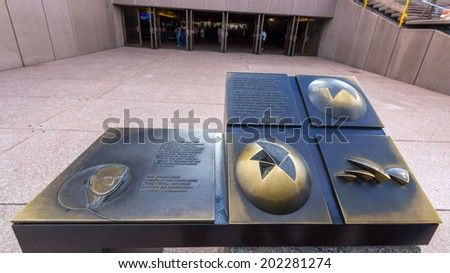 SYDNEY, NSW, AUSTRALIA - May 30, 2014: Design of Sydney opera house displayed in front of Sydney Opera House. It was designed by Danish architect Jorn Utzon, the facility formally opened in 1973. - stock photo