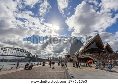 SYDNEY, NSW, AUSTRALIA - May 30, 2014: Sydney opera house and harbor bridge. The opera house provides a venue for the performing arts in Australia's largest city, Sydney.