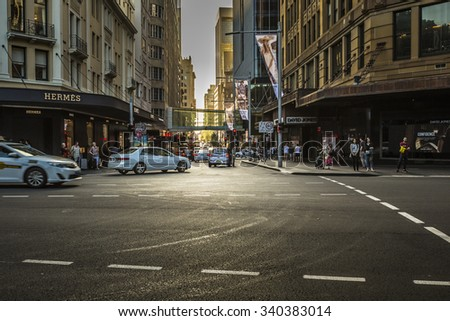 SYDNEY - OCTOBER 27: Tourists along city streets, October 27, 2015 in Sydney. The city receives 7.5 million domestic overnight visitors every year. - stock photo