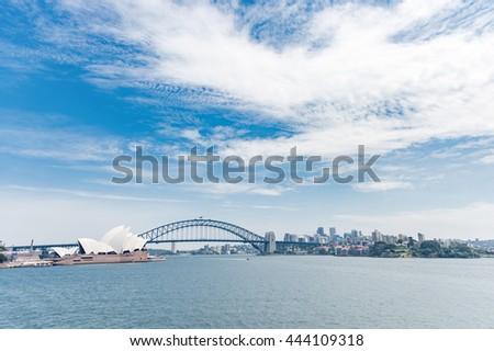 Sydney Opera House and Harbour Bridge. Australia. River Water. Wide Angle - stock photo