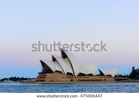 Sydney Opera House on pink and blue sky. 29 AUG 2016  It was designed by Danish architect Jorn Utzon .