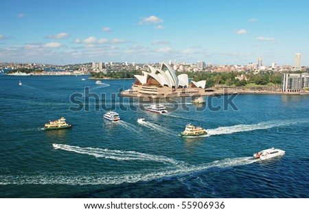 Sydney opera house with ferrys in foregournd, taken from harbor bridge - stock photo