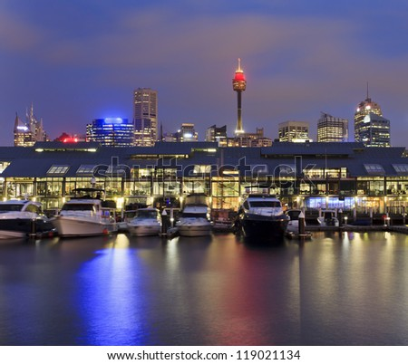 sydney pyrmont bay view on docks with marina boats at sunrise sydney tower above roofs of apartments - stock photo