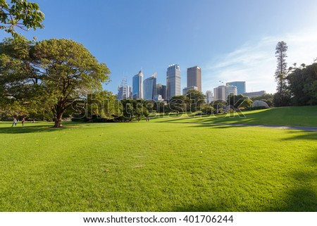 Sydney's Hyde Park and distant buildings - stock photo