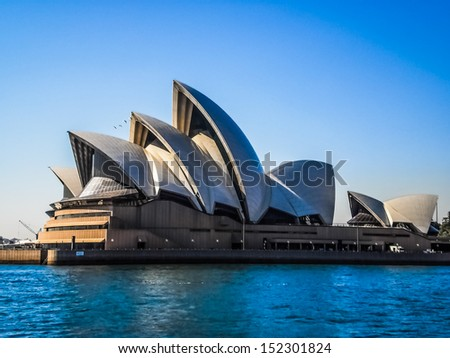 SYDNEY-SEPTEMBER 22 : Sydney opera house with blue sky in  Sydney,Australia on 22 September 2012 .It was designed by Danish architect Jorn Utzon.